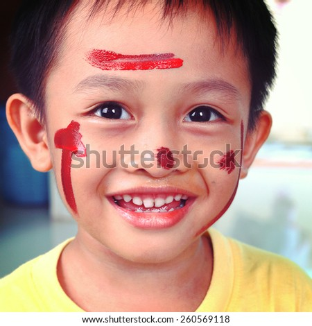 Little boy paint on face-instagram filter - stock photo