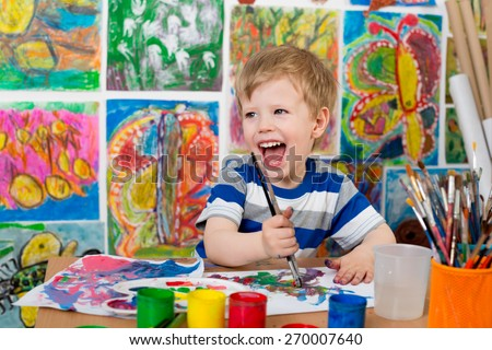 Little Boy Painting - stock photo