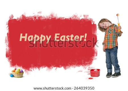 Little boy painting a Happy Easter banner on the wall  - stock photo