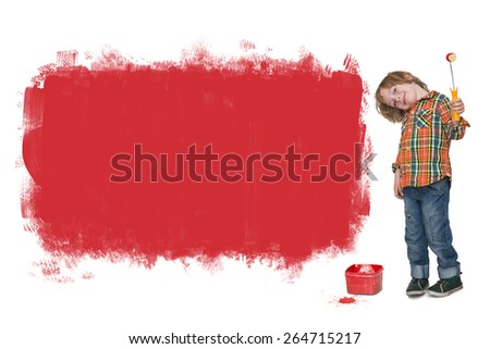 Little boy painting a red banner on the wall