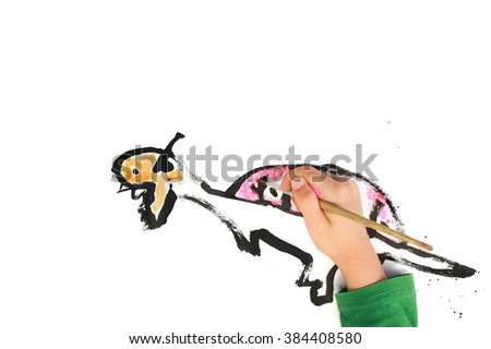 Little boy painting dinosaur. - stock photo