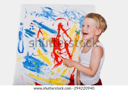 Little boy painting on canvas. Education. Creativity. Studio portrait over white background - stock photo