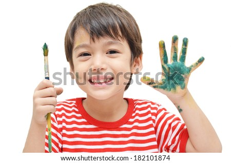 Little boy painting on white background - stock photo