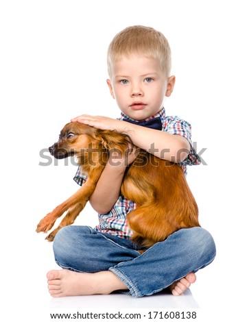 little boy patting dog head. isolated on white background - stock photo