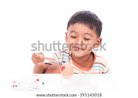 little boy play paint easter egg