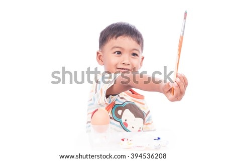 little boy play painting on face   - stock photo