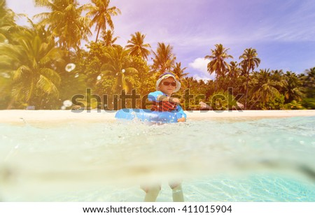 little boy play with water on tropical beach - stock photo