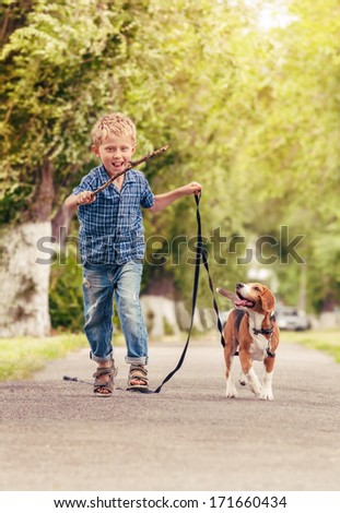 Little boy playing and training his favorite pet - stock photo
