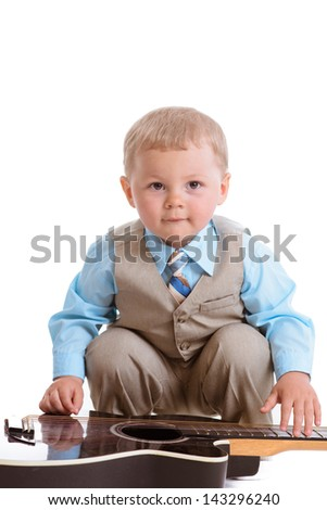 little boy playing guitar - stock photo