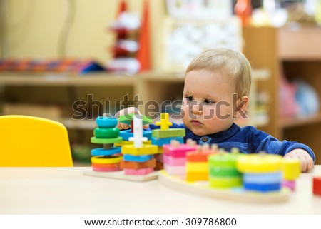 little boy playing in a kindergarten - stock photo