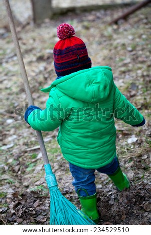little boy playing in countryside