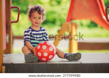 Little boy playing in the playground