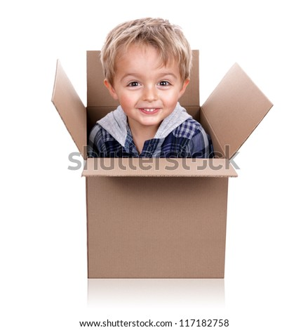 Little boy playing jack in the box with a cardboard box - stock photo