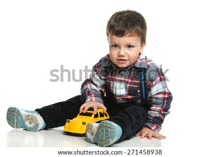 little boy playing machine. good emotions. studio photography - stock photo