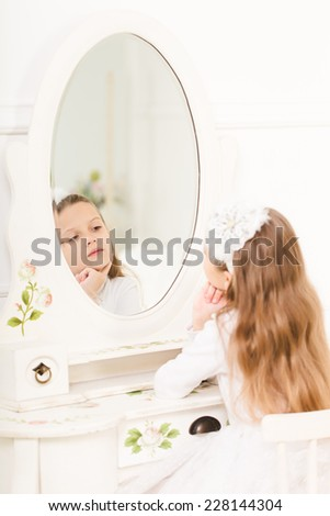 little boy playing on a big white bed - stock photo
