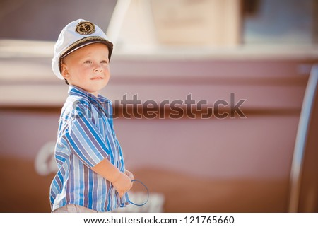 Little boy playing outdoor on the pier - stock photo