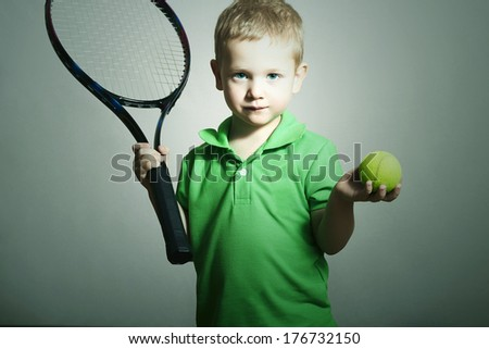 Little Boy Playing Tennis. Sport Children. Child with Tennis Racket and Ball - stock photo