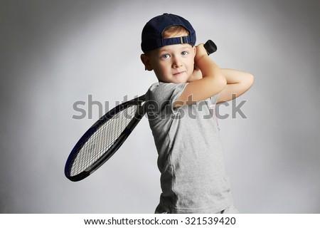 Little Boy Playing Tennis. Sport kids.Child with Tennis Racket.healthy children - stock photo