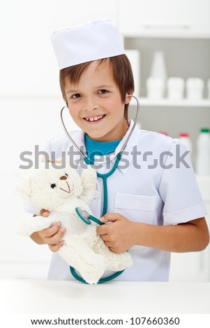 Little boy playing veterinary doctor with stethoscope - stock photo
