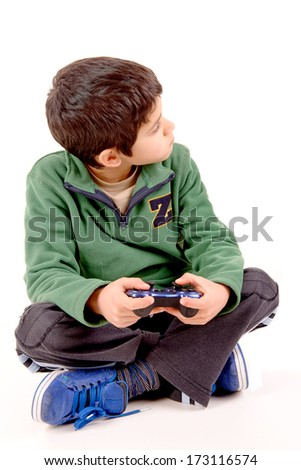 little boy playing videogames isolated in white
