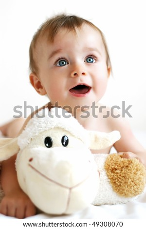 Little boy playing with a lamb - stock photo