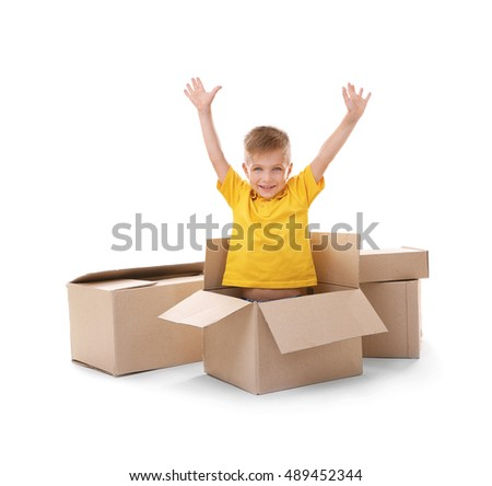 Little boy playing with cardboard boxes isolated on white