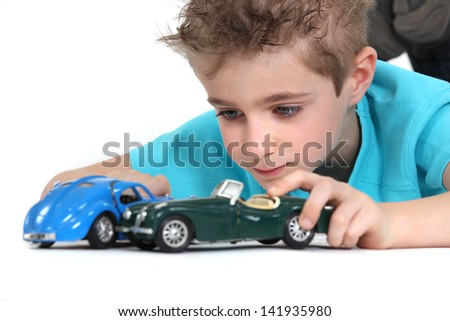 little boy playing with cars - stock photo