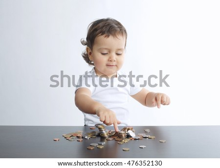little boy playing with coins