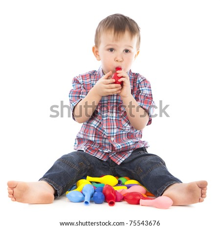 Little boy playing with inflatable balls colored white background isolated - stock photo