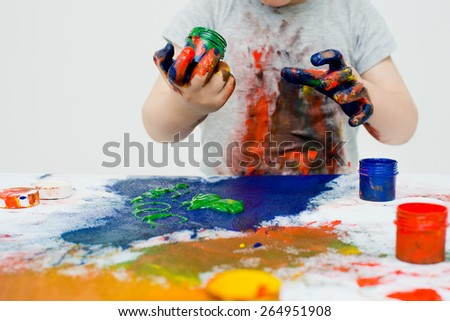 little boy playing with paints - stock photo