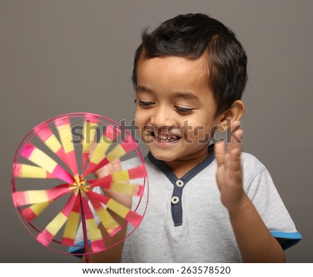 Little boy playing with paper toy - stock photo