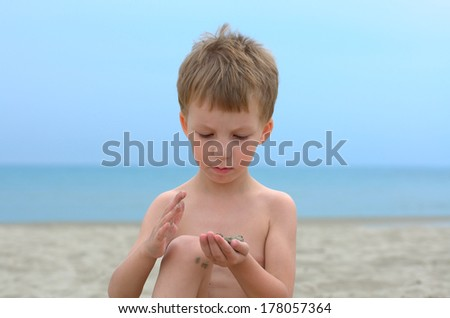 little boy playing with sand - stock photo