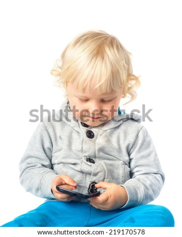 Little boy playing with smart phone - stock photo