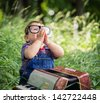 little boy playing with the accordion - stock photo