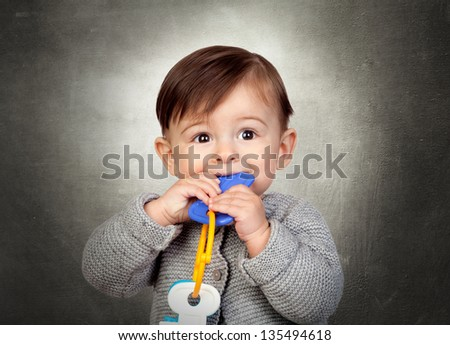 Little Boy Playing With Toy Key Over Colored Background - stock photo