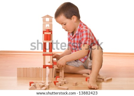 Little boy playing with wooden blocks - isolated - stock photo