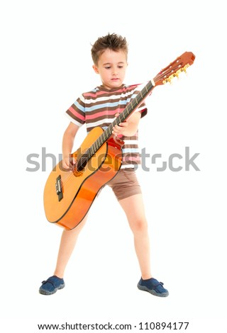 Little boy plays acoustic guitar isolated on white