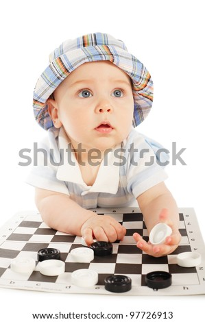 little boy plays checkers