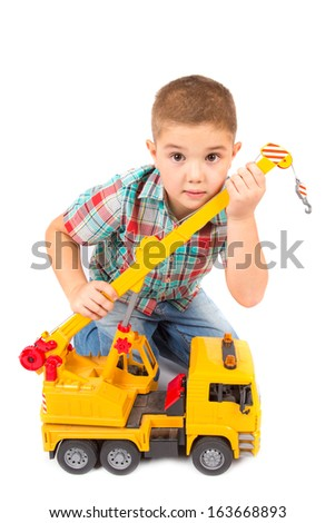 little boy plays with toy truck