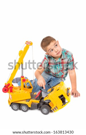 little boy plays with toy truck - stock photo