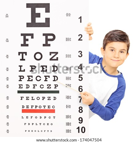 Little boy pointing on an eyesight test with stick isolated on white background, shot with tilt and shift lens - stock photo