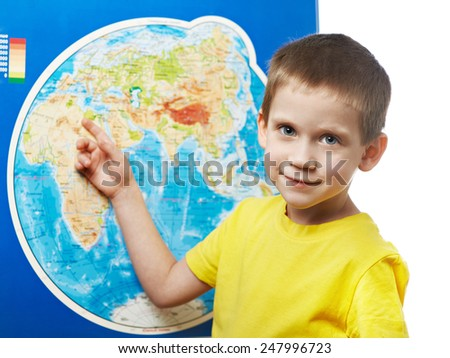 Little boy points to a place on the world map.