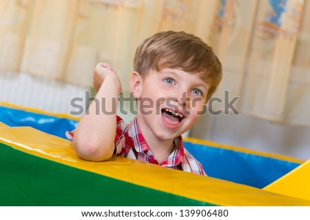 Little boy portrait with beautiful blue eyes - stock photo
