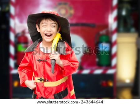 Little boy pretend as a fire fighter - stock photo