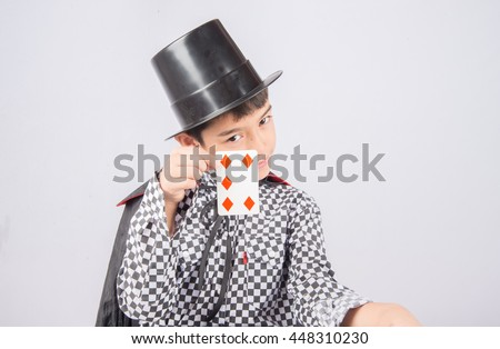 Little boy pretend as a magician performance with fun - stock photo