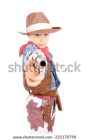 little boy pretending to be a cowboy isolated in white - stock photo