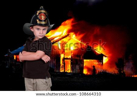 Little boy pretending to be a firefighter - stock photo