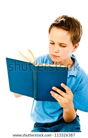 little boy reading book isolated on a white background