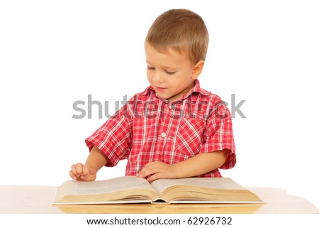 Little boy reading book on the desk, isolated on white