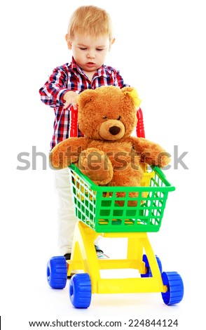 Little boy riding in the truck of a teddy bear.Early years learning a happy childhood concept.Isolated on white background. - stock photo